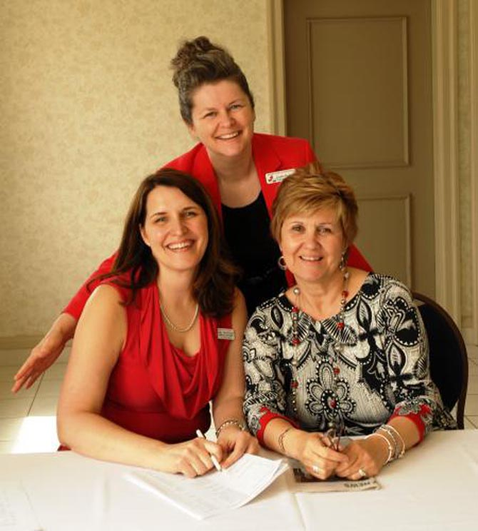 Gisèle Budgell and Judy Maidment with Darlene Edmonds