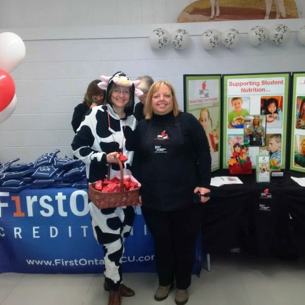 Cow mascot, Karen Gibbons, and Nancy Waldschmidt, Volunteer Development Coordinator and event planner