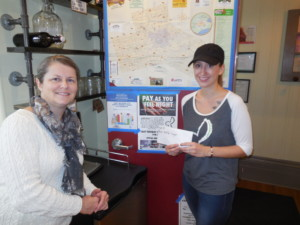 Mia Vamos-Yuhasz of the Healthy Rabbit presents donation to Gisèle Budgell, Program Director, Brant Food For Thought